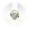 size 7.5 Sterling, 14k, 22k Deckled Edge Coin Pearl Ring by Judie Raiford on white ring display stand