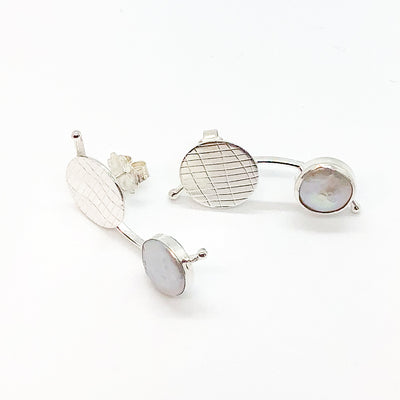 side angle view of Sterling Silver Comet Earrings with White Coin Pearl by Judie Raiford