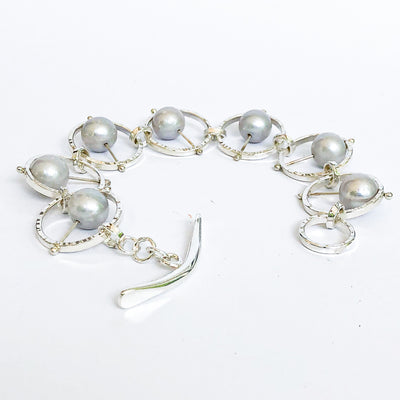 Side angle view of Not Naught Round Sterling Bracelet with Gray Pearls by Judie Raiford