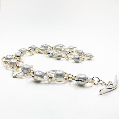 side angle view of Sterling Not Naught Round Necklace with Gray Pearls by Judie Raiford