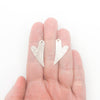 Sterling Silver Textured Heart Earrings by Judie Raiford held in hand