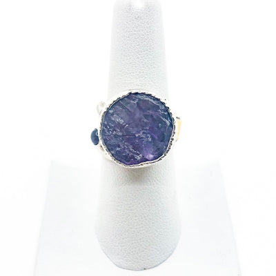 size 8 Sterling 14k, 22k Deckled Edge Natural Surface Amethyst Ring by Judie Raiford on white ring display stand