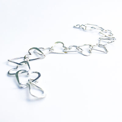 side angle view of Sterling Mini Heart Bracelet by Judie Raiford