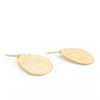 side angle view of 14k Gold Filled Mom's Hammer Flat Pear Earrings by Judie Raiford