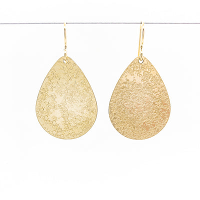 14k Gold Filled Mom's Hammer Flat Pear Earrings by Judie Raiford hanging on a wire