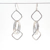 Sterling JW Earrings by Judie Raiford hanging on a wire