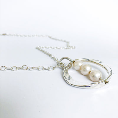 angle view of Large Naught Necklace with 3 White Pearls by Judie Raiford