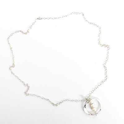 flat lay view of Large Naught Necklace with 3 White Pearls by Judie Raiford