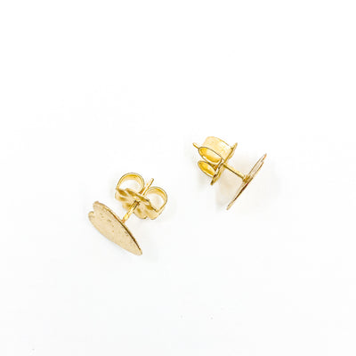 over top view of 14k Gold Filled Paper Textured Heart Stud Earrings by Judie Raiford
