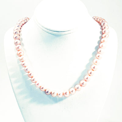 Blush Pearl Necklace by Judie Raiford on white jewelry display bust