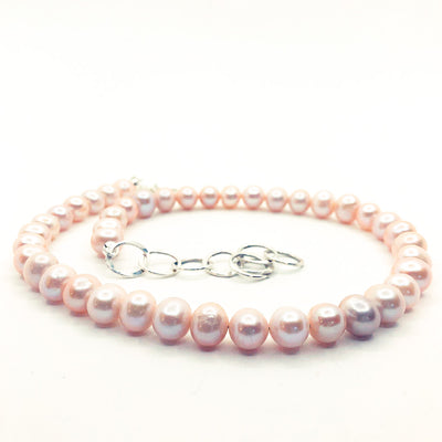 side angle view of Blush Pearl Necklace by Judie Raiford