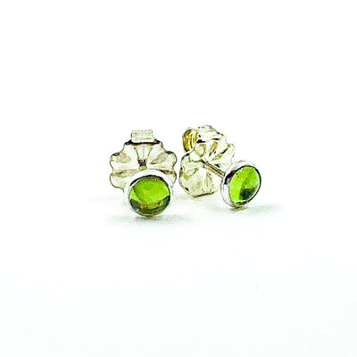 side angle view of 6mm Peridot Cabochon Stud Earrings by Judie Raiford