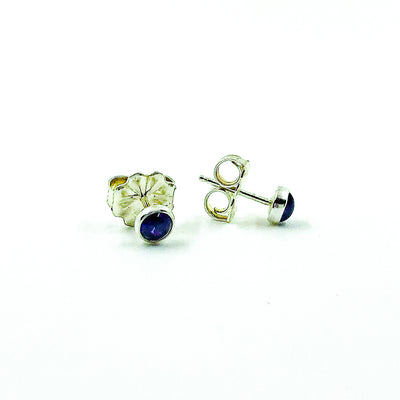 side angle view of 5mm Amethyst Cabochon Stud Earrings by Judie Raiford