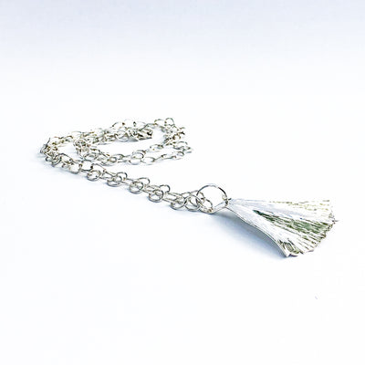 side angle view of Large Sterling Ginkgo Ra Ra Necklace by Judie Raiford