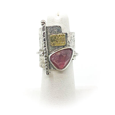 size 6 Sterling and 22k Gold Deckled Edge Bar Ring with Pink Tourmaline by Judie Raiford displayed on white ring display stand