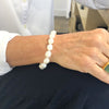 Sterling White Small Baroque Pearl Bracelet with Heart Clasp by Judie Raiford worn on model