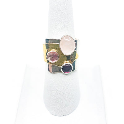 size 9.5 Sterling & 24k Crotch Hugger Ring with Pink Quartz, Pink Tourmaline, and Garnet by Judie Raiford on white ring display stand