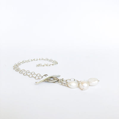 angle flat lay of Dale 3-Pearl Lariat Necklace by Judie Raiford