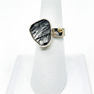 size 8 Sterling and 14k Rose Cut Tourmalated Quartz Ring with Diamond by Judie Raiford on white ring display stand
