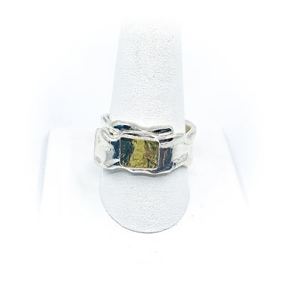 size 10.5 Men's Sterling and 22k Anticlastic Deckled Band Ring by Judie Raiford on white ring display stand