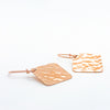 side angle flat lay 14k Rose Gold Ball Pein Square Earrings by Judie Raiford
