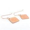 back side view of 14k Rose Gold Ball Pein Square Earrings by Judie Raiford