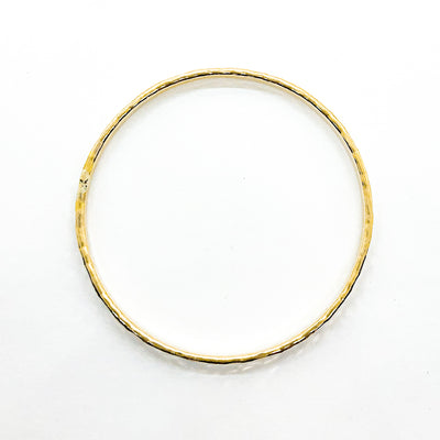 over top view of 14k Gold Filled Ball Pein Hammered Bangle by Judie Raiford