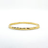 14k Gold Filled Ball Pein Hammered Bangle by Judie Raiford
