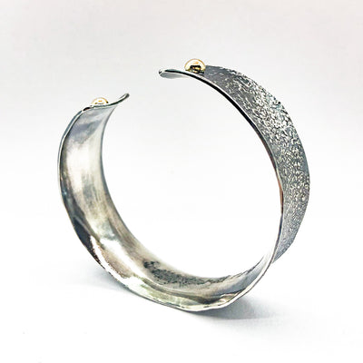 "side angle view of 3/4"" Mom's Hammer Oxidized Sterling Anticlastic Cuff with 14k Gold Balls by Judie Raiford"