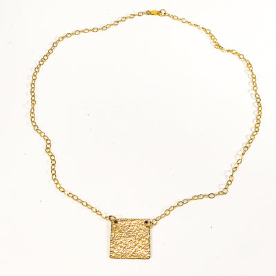 flat lay view of 14k Gold Filled Mom's Hammer Square Necklace by Judie Raiford