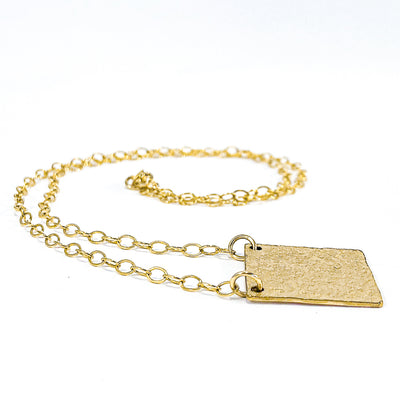 side angle view of 14k Gold Filled Mom's Hammer Square Necklace by Judie Raiford