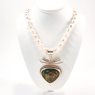 Labradorite Pendant on 3 Blade Setting on Strand of Blush Teardrop Pearls by Judie Raiford on white jewelry display bust