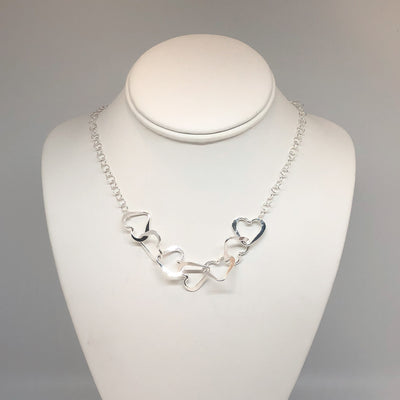 Hammered Sterling Silver 7 Heart Necklace by Judie Raiford on mannequin