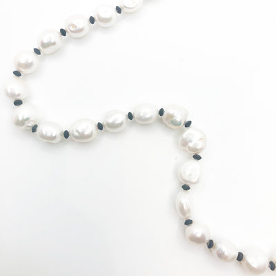 bead detail view of Sterling Large White Baroque Pearl Necklace with Sandblasted Black Onyx by Judie Raiford