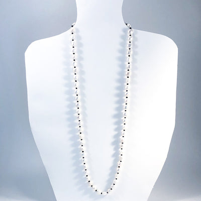 long style of Sterling Large White Baroque Pearl Necklace with Sandblasted Black Onyx by Judie Raiford on white display mannequin