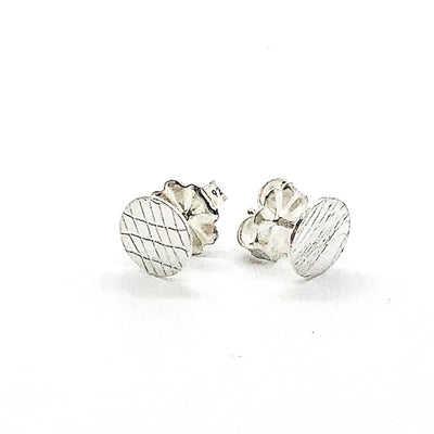 side angle view of Sterling Textured Circle Stud Earrings by Judie Raiford