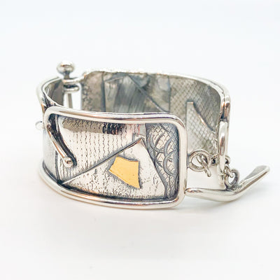 angle side view of sterling silver and 24k gold Flashed and Fused Bracelet by Judie Raiford