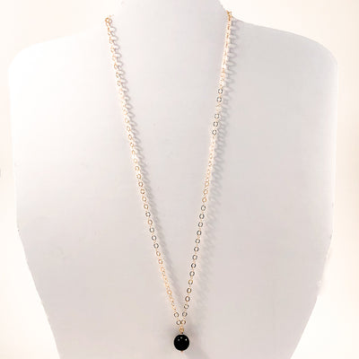 Black Onyx and 14k Gold Filled Necklace by Judie Raiford displayed on white mannequin