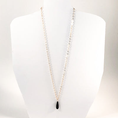 Faceted Tear Drop Black Onyx on 14k Gold Chain by Judie Raiford hanging on white display mannequin
