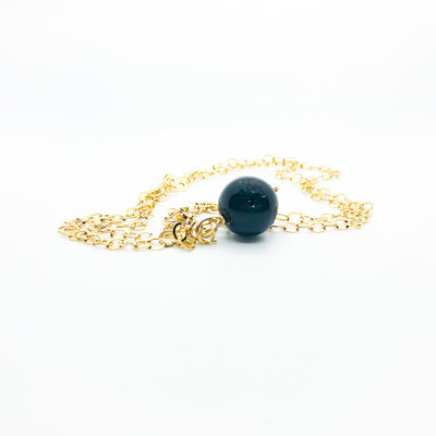 side angle view of Black Onyx and 14k Gold Filled Necklace by Judie Raiford