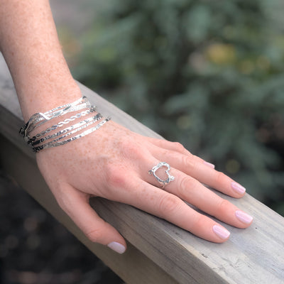 Sterling Orbit Bangle by Judie Raiford worn on model