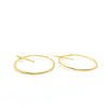 side angle view of 14k Gold Filled Large Orbit Earrings by Judie Raiford
