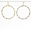 14k Gold Filled Large Orbit Earrings by Judie Raiford hanging on a wire