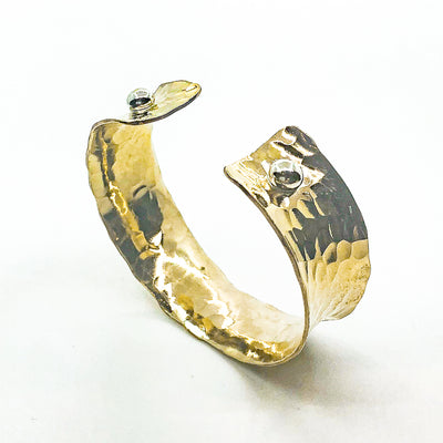 "side angle view of 3/4"" 14k Gold Filled 3/4"" Ball Pein Anticlastic Cuff by Judie Raiford"