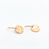 side angle view of 14k Gold Filled ball Pein Hammered Mini Circle Earrings by Judie Raiford