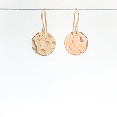 14k Gold Filled ball Pein Hammered Mini Circle Earrings by Judie Raiford hanging on wire