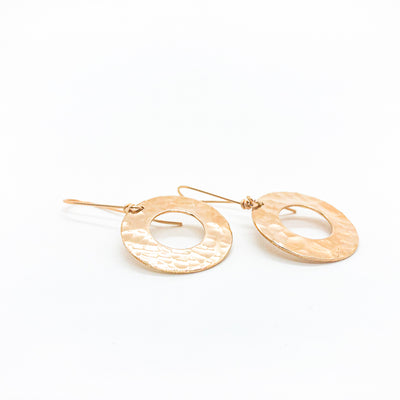 side angle view of 14k Gold Filled Ball Pein Donut Earrings on handmade wire by Judie Raiford