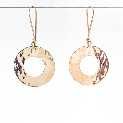 14k Gold Filled Ball Pein Donut Earrings on handmade wire by Judie Raiford hanging on wire