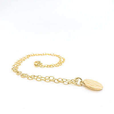 side angle view of 14k Gold Filled Hammered Mini Circle Necklace by Judie Raiford