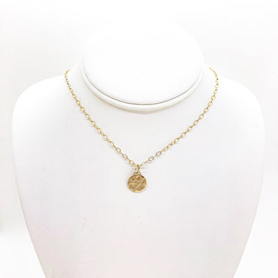 14k Gold Filled Hammered Mini Circle Necklace by Judie Raiford displayed on a white mannequin bust